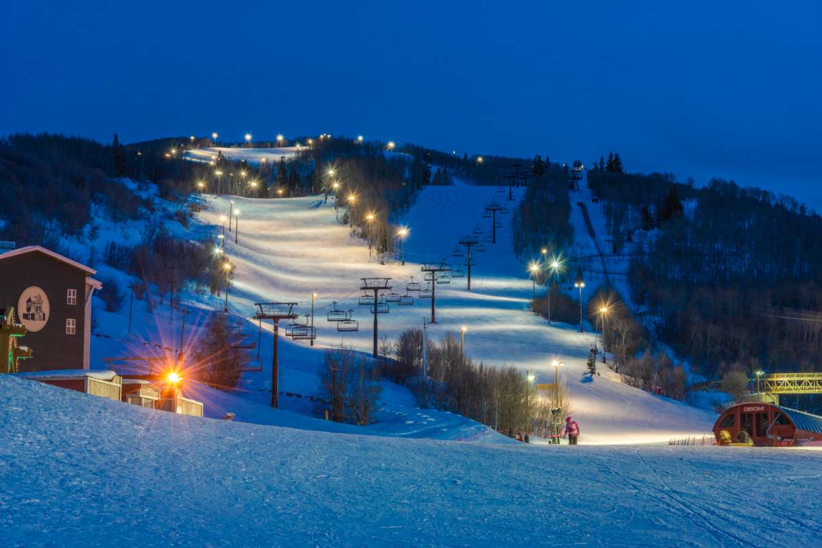 Ski slopes at night light up by lights, view from the best-located home in Park City.
